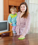 Mother with child cleaning home Royalty Free Stock Photo