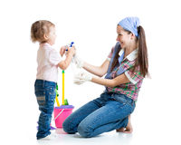 Mother with child cleaning room and having fun Stock Images