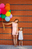 Mother and child with colorful balloons Royalty Free Stock Photo