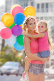 Mother and child with colorful balloons Stock Image