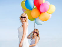 Mother and child with colorful balloons Stock Photos