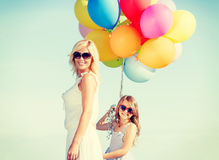 Mother and child with colorful balloons Royalty Free Stock Image