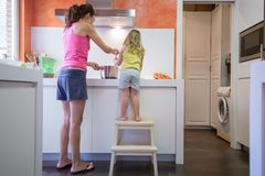 Mother and child cooking together Royalty Free Stock Photo