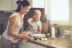 Mother with child cooking together Stock Photos