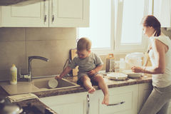Mother with child cooking together Royalty Free Stock Photo