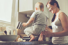 Mother with child cooking together Stock Images