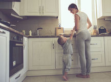 Mother with child cooking together Royalty Free Stock Images