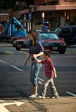 Mother and Child Crossing the Street Stock Images