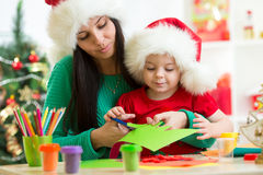 Mother and child cut preparing to Christmas Stock Image