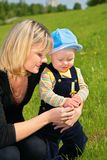 Mother with child and dandelion on meadow Stock Photography