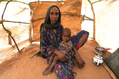 Mother and Child in Darfur. September 22, 2004 -A woman displaced by fighting sits with her child in the Riyad camp near El Geneina, East Darfur, Sudan Royalty Free Stock Photos