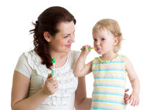 Mother and child daughter brushing teeth in bathroom Royalty Free Stock Photos