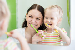 Mother And Child Daughter Brushing Teeth Together Stock Images