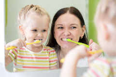 Mother And Child Daughter Brushing Teeth Together. Mother And KId Daughter Brushing Teeth Together Royalty Free Stock Photography