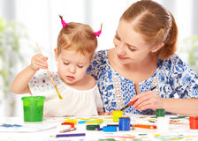 Mother and child  daughter draw paints Stock Photography
