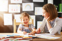 Mother and child daughter draws in creativity in kindergarten Stock Photos