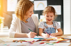 Mother and child daughter draws in creativity in kindergarten Royalty Free Stock Photography
