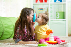 Mother with child daughter play Stock Images