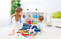 Mother and child daughter playing, build from constructor Royalty Free Stock Photo