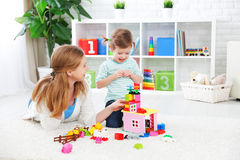 Mother and child daughter playing, build from constructor Stock Image