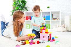 Mother and child daughter playing, build from constructor Royalty Free Stock Images