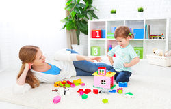 Mother and child daughter playing, build from constructor Stock Photos