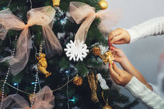 Mother and child decorate the Christmas tree. Stock Image