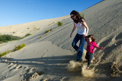 Mother and child in the desert Stock Images