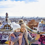 Mother and child with digital camera taking photo in Barcelona Royalty Free Stock Photo