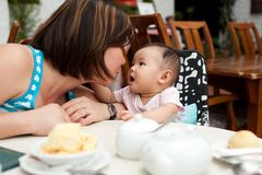 Mother and child at the dining table Royalty Free Stock Photography