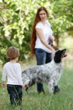 Mother and child with dog outdoors Royalty Free Stock Photos