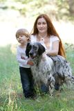 Mother and child with dog outdoors stock image