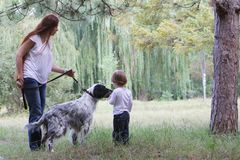 Mother and child with dog outdoors Royalty Free Stock Image