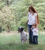 Mother and child with dog outdoors Stock Images