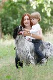 Mother and child with dog outdoors Stock Photo