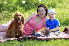 Mother, child and dog on picnic Royalty Free Stock Photography