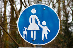 Mother child dog road sign blue white Stock Images