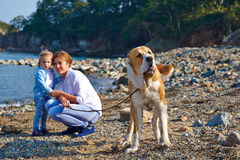 Mother with child and dog walk stock images