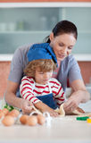 Mother and child doing Christmas baking Royalty Free Stock Photos