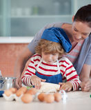 Mother and child doing Christmas baking Stock Images