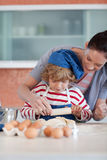Mother and child doing Christmas baking Royalty Free Stock Photo