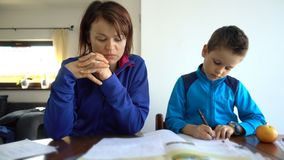 Mother and child doing school homework, 4K resolution. Hd video stock video