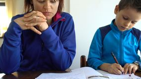 Mother and child doing school homework. Hd video stock footage