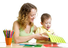Mother and child draw and cut together Royalty Free Stock Image