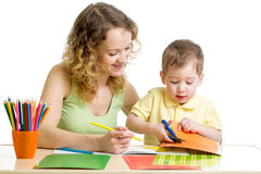 Mother and child draw and cut together Royalty Free Stock Images