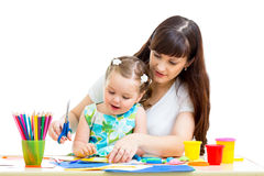 Mother and child draw and cut together Stock Photo