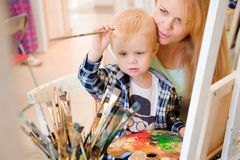 Mother and child draw a picture paints, art lesson. Mother and child draw a picture paints, art lesson royalty free stock photo