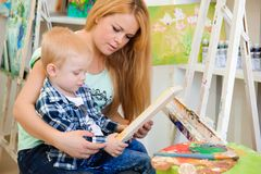 Mother and child draw a picture paints, art lesson. Mother and child draw a picture paints, art lesson royalty free stock photography