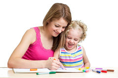 Mother and child draw together Royalty Free Stock Photos