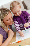 Mother and child drawing. Photo shot of mother and child drawing stock photo
